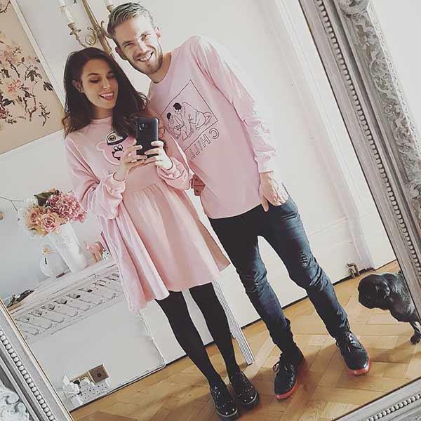 Marzia Bisognin and her Youtubers boyfriend Pewdiepie in pink dress