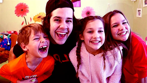 Image of David Dobrik with his siblings