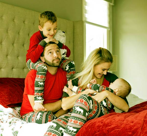 Image of Andy Schrock with wife Brittany Lynn and with their kids