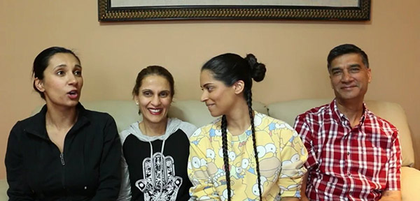 Image of Lilly Singh with her parents and sister Tina